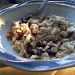 bowl of oatmeal with craisins and walnuts