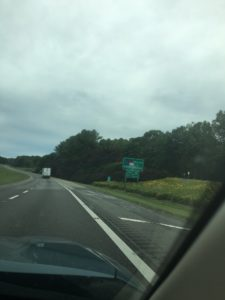 View of a Welcome to North Carolina sign from the passenger seat of a car