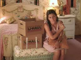 Sandra Bullock in Hope Floats.  Just moved home, moving boxes cluttering her childhood bedroom, she looks overwhelmed and sad.