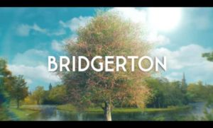 Bridgerton title card: landscape painint with a blooming fruit tree with pink flowers at the center, Briderton written in white all caps font across the tree in the exact center of the image.